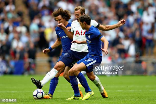 Harry Kane of Tottenham Hotspur is challenged by David Luiz and Andreas Christensen both of Chelsea during the Premier League match between Tottenham...