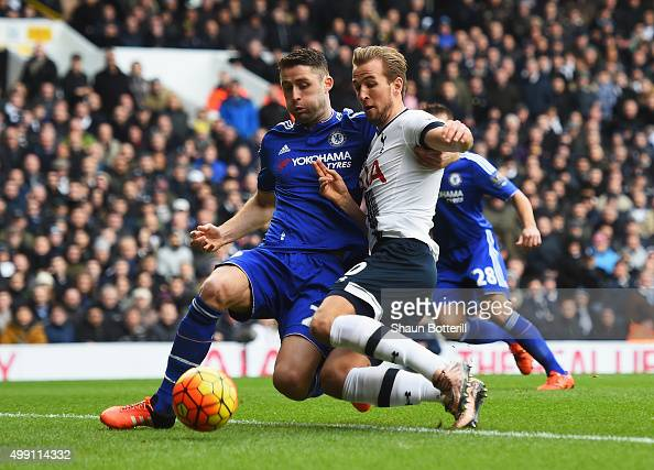Harry Kane of Tottenham Hotspur is challenged by Gary Cahill of Chelsea during the Barclays Premier League match between Tottenham Hotspur and...