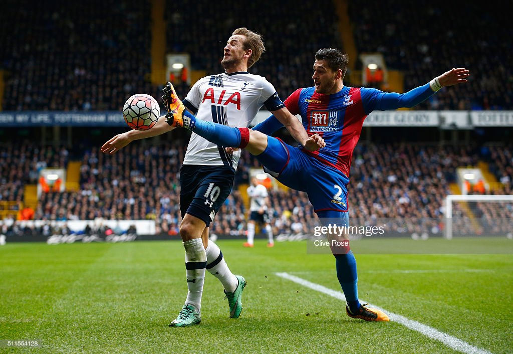 Harry Kane of Tottenham Hotspur is challenged by Joel Ward of Crystal Palace during the Emirates FA Cup Fifth Round match between Tottenham Hotspur and Crystal Palace at White Hart Lane on February 21, 2016 in London, England.