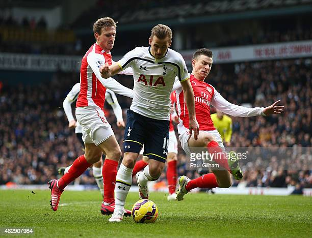 Harry Kane of Tottenham Hotspur is challenged by Laurent Koscielny and Nacho Monreal of Arsenal during the Barclays Premier League match between...