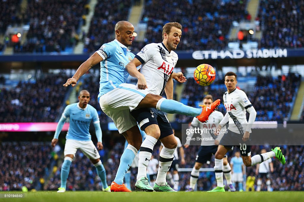 <a gi-track='captionPersonalityLinkClicked' href=/galleries/search?phrase=Harry+Kane+-+Soccer+Player&family=editorial&specificpeople=13636610 ng-click='$event.stopPropagation()'>Harry Kane</a> of Tottenham Hotspur is challenged by <a gi-track='captionPersonalityLinkClicked' href=/galleries/search?phrase=Vincent+Kompany&family=editorial&specificpeople=504694 ng-click='$event.stopPropagation()'>Vincent Kompany</a> of Manchester City during the Barclays Premier League match between Manchester City and Tottenham Hotspur at Etihad Stadium on February 14, 2016 in Manchester, England.