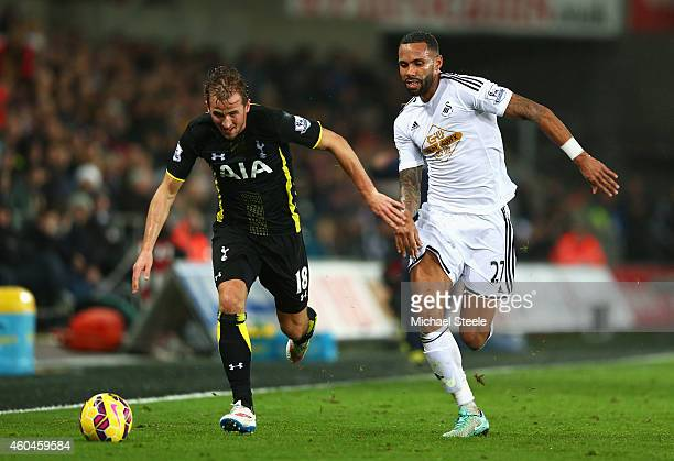 Harry Kane of Tottenham Hotspur is closed down by Kyle Bartley of Swansea City during the Barclays Premier League match between Swansea City and...