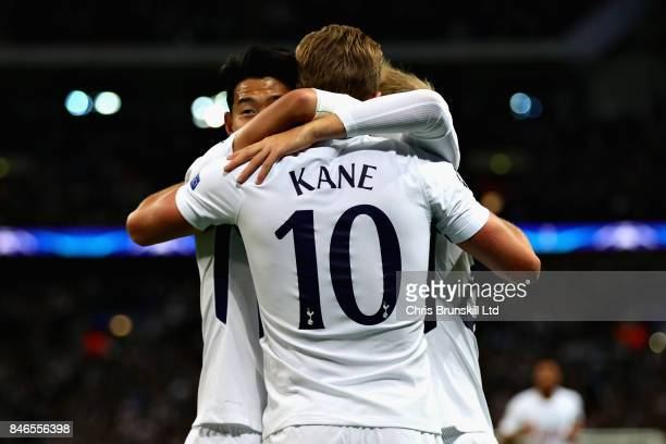 Harry Kane of Tottenham Hotspur is congratulated by teammates after scoring his sides second goal during the UEFA Champions League group H match...