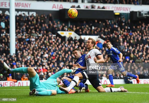 Harry Kane of Tottenham Hotspur is foiled by Asmir Begovic and Gary Cahill of Chelsea during the Barclays Premier League match between Tottenham...
