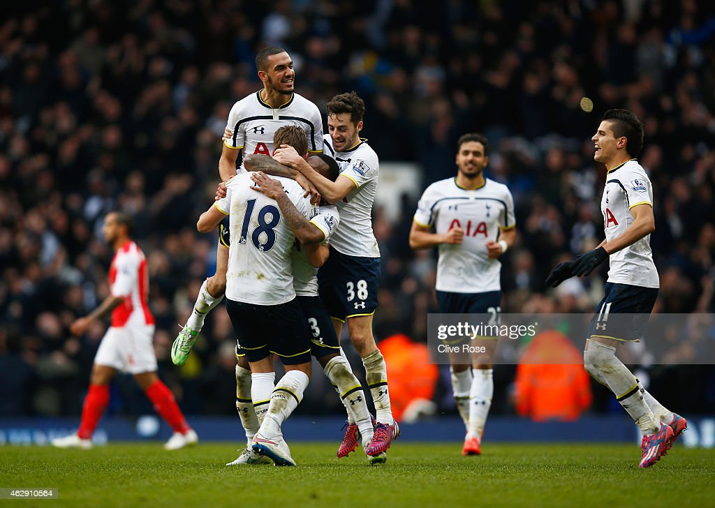 Harry Kane of Tottenham Hotspur is mobbed by team mates as they celebrate victory during the Barclays Premier League match between Tottenham Hotspur and Arsenal at White Hart Lane on February 7, 2015 in London, England.