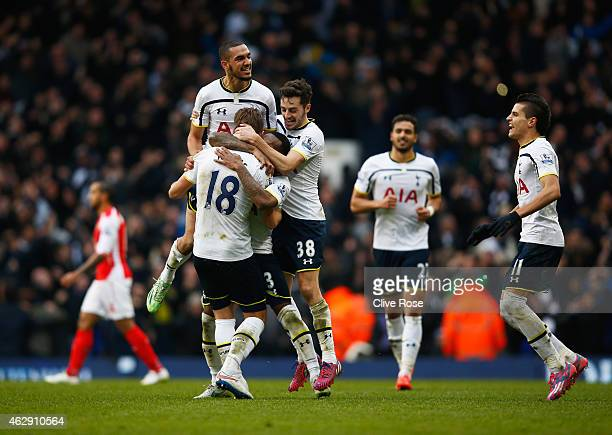 Harry Kane of Tottenham Hotspur is mobbed by team mates as they celebrate victory during the Barclays Premier League match between Tottenham Hotspur...