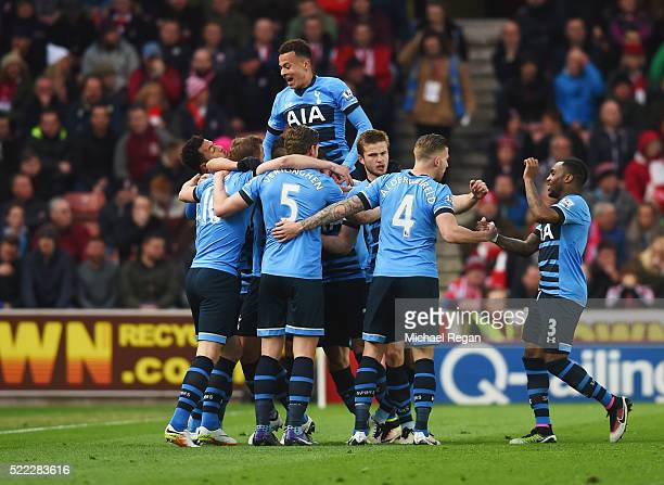 Harry Kane of Tottenham Hotspur is mobbed by team mates in celebration as he scores their first goal during the Barclays Premier League match between...