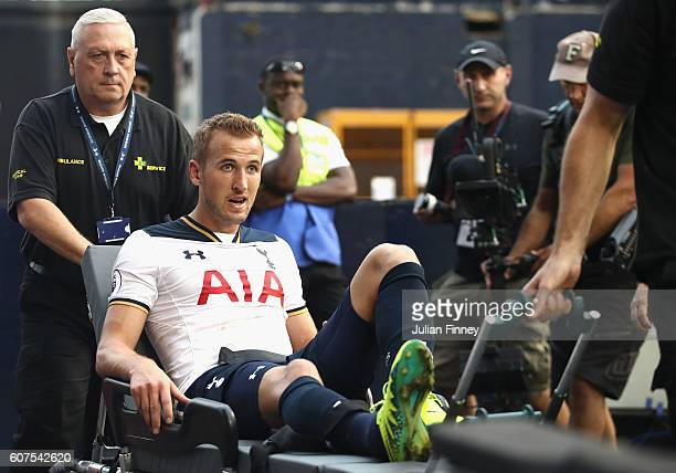 Harry Kane of Tottenham Hotspur is put onto a stretcher after coming off injured during the Premier League match between Tottenham Hotspur and...