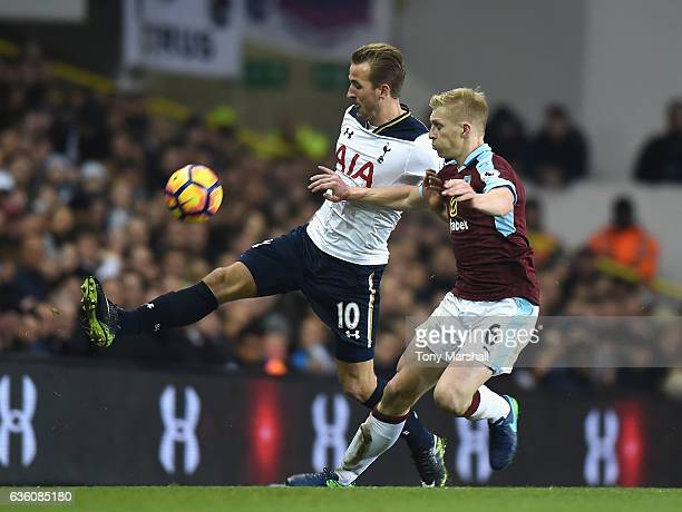 Harry Kane of Tottenham Hotspur is tackled by Ben Mee of Burnley during the Barclays Premier League match between Tottenham Hotspur and Burnley at...