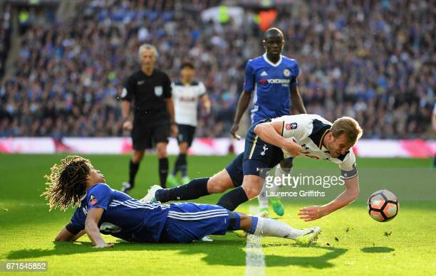 Harry Kane of Tottenham Hotspur is tackled by Nathan Ake of Chelsea during The Emirates FA Cup SemiFinal between Chelsea and Tottenham Hotspur at...