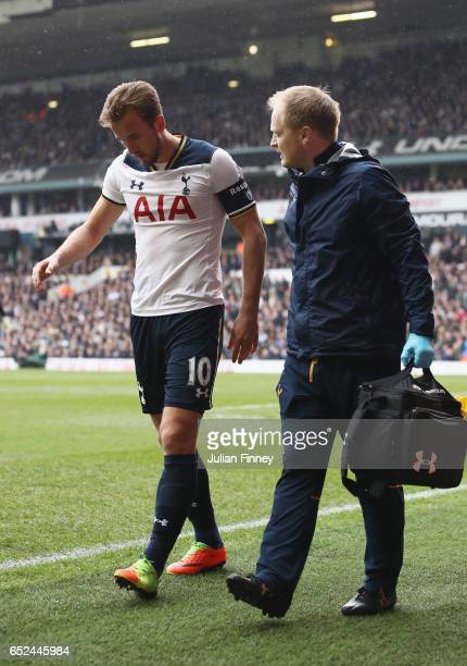 Harry Kane of Tottenham Hotspur is taken off injured during The Emirates FA Cup QuarterFinal match between Tottenham Hotspur and Millwall at White...