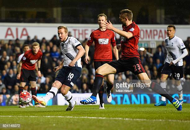 Harry Kane of Tottenham Hotspur misses a chance as Gareth McAuley of West Bromwich Albion moves in during the Barclays Premier League match between...