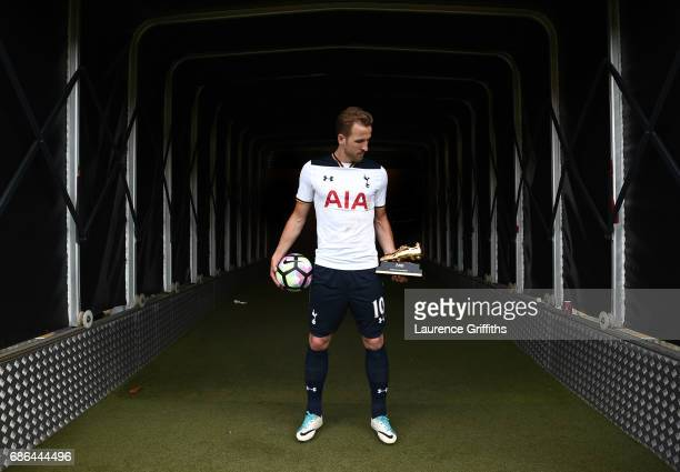 Harry Kane of Tottenham Hotspur poses in the tunnel with the golden boot and match ball after the Premier League match between Hull City and...