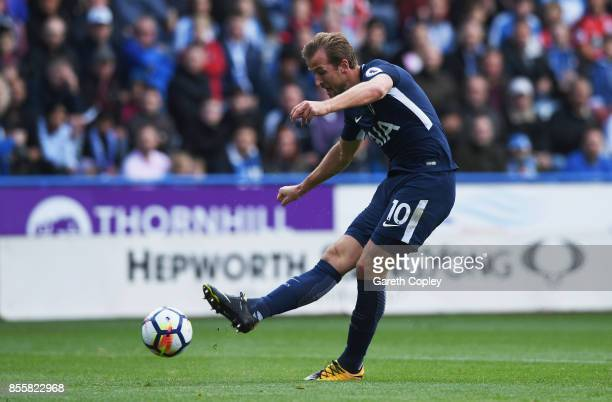 Harry Kane of Tottenham Hotspur scores his sides first goal during the Premier League match between Huddersfield Town and Tottenham Hotspur at John...