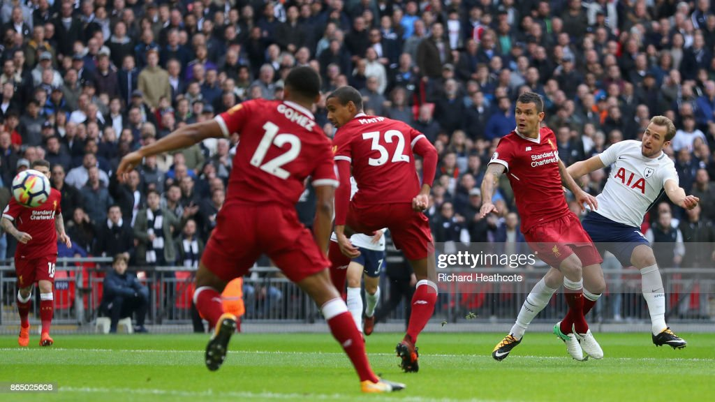 Harry Kane of Tottenham Hotspur scores his sides first goal while under pressure from Dejan Lovren of Liverpool during the Premier League match between Tottenham Hotspur and Liverpool at Wembley Stadium on October 22, 2017 in London, England.