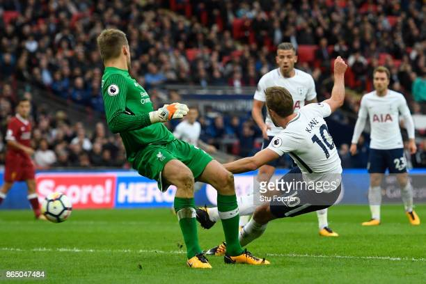 Harry Kane of Tottenham Hotspur scores his sides fourth goal during the Premier League match between Tottenham Hotspur and Liverpool at Wembley...