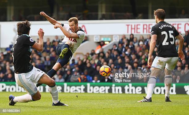 Harry Kane of Tottenham Hotspur scores his sides third goal during the Premier League match between Tottenham Hotspur and West Bromwich Albion at...