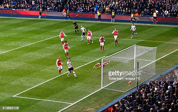 Harry Kane of Tottenham Hotspur scores his team's first goal during the Barclays Premier League match between Tottenham Hotspur and Arsenal at White...