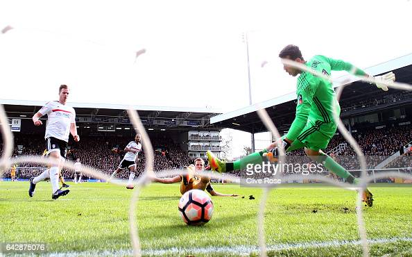 Harry Kane of Tottenham Hotspur scores their first goal past goalkeeper Marcus Bettinelli of Fulham during The Emirates FA Cup Fifth Round match...