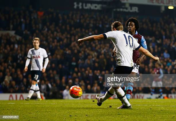 Harry Kane of Tottenham Hotspur scores their third goal during the Barclays Premier League match between Tottenham Hotspur and Aston Villa at White...