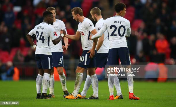 Harry Kane of Tottenham Hotspur shakes hands with his team mates as he is substituted during the Premier League match between Tottenham Hotspur and...