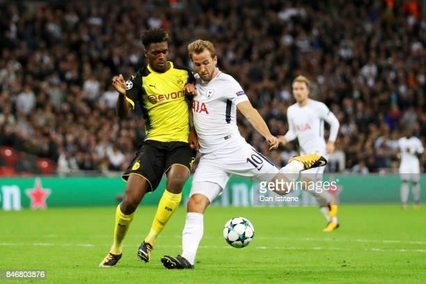 Harry Kane of Tottenham Hotspur shoots against the Tottenham Hotspur goal under pressure from DanAxel Zagadou of Borussia Dortmund during the UEFA...
