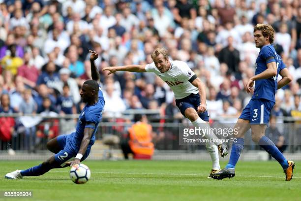 Harry Kane of Tottenham Hotspur shoots as Antonio Rudiger of Chelsea attempts to block during the Premier League match between Tottenham Hotspur and...