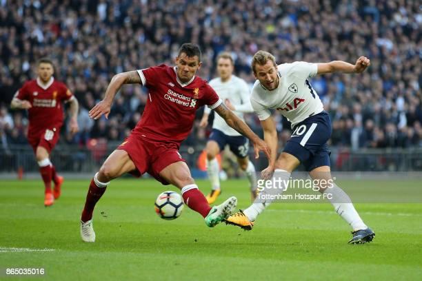 Harry Kane of Tottenham Hotspur shoots as Dejan Lovren of Liverpool attempts to block during the Premier League match between Tottenham Hotspur and...