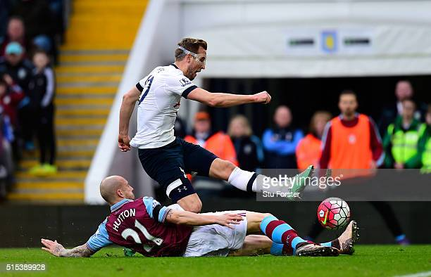 Harry Kane of Tottenham Hotspur shoots past Alan Hutton of Aston Villa to score their first goal during the Barclays Premier League match between...