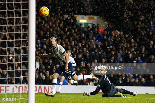 Harry Kane of Tottenham Hotspur shoots past Kasper Schmeichel of Leicester City hitting a cross bar during the Barclays Premier League match between...