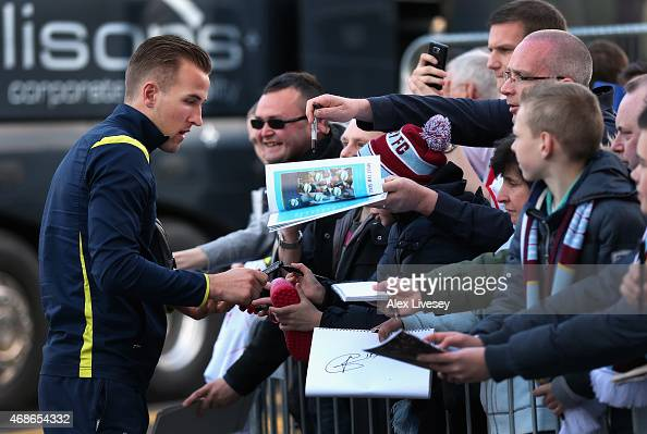 Harry Kane of Tottenham Hotspur signs autographs for fans as he arrives at Turf Moor prior to the Barclays Premier League match between Burnley and...