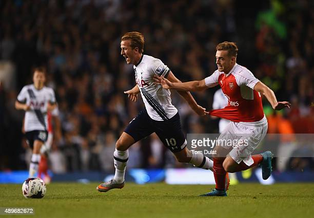 Harry Kane of Tottenham Hotspur takes on Calum Chambers of Arsenal during the Capital One Cup third round match between Tottenham Hotspur and Arsenal...