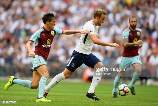 Harry Kane of Tottenham Hotspur takes the ball past Jack Cork of Burnley during the Premier League match between Tottenham Hotspur and Burnley at...