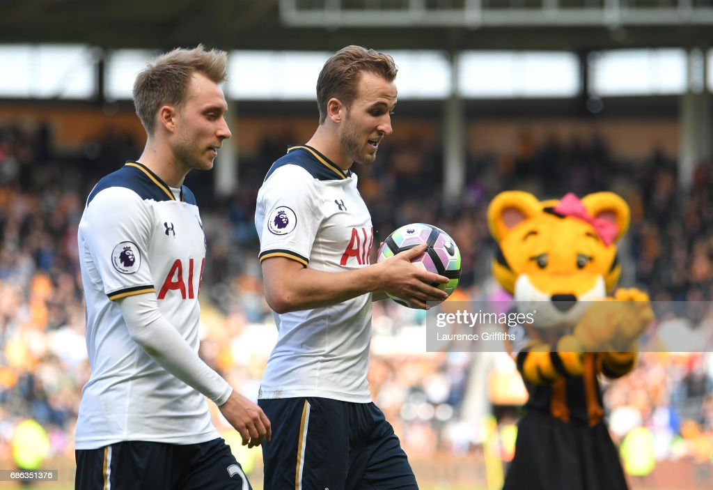 Harry Kane of Tottenham Hotspur walks off the pitch alongside Christian Eriksen after scoring a hat-trick and winning the Premier League Golden Boot award during the Premier League match between Hull City and Tottenham Hotspur at KC Stadium on May 21, 2017 in Hull, England.