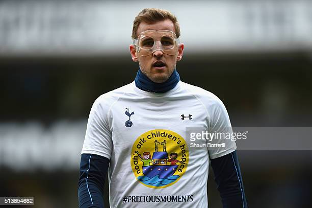 Harry Kane of Tottenham Hotspur warms up wearing a protective face mask prior to the Barclays Premier League match between Tottenham Hotspur and...