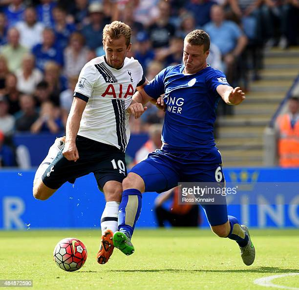 Harry Kane oif Tottenham is challenged by Robert Huth of Leicester during the Barclays Premier League match between Leicester City and Tottenham...