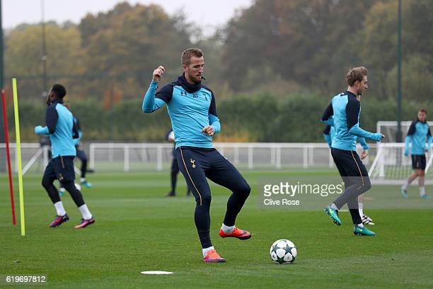 Harry Kane passes the ball during a Tottenham Hotspur training session ahead of their UEFA Champions League Group E match against Bayer 04 Leverkusen...