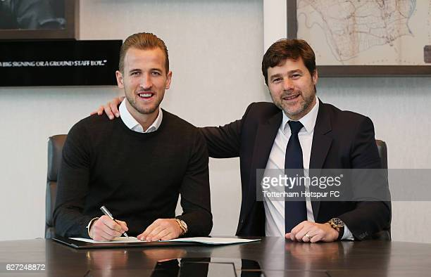 Harry Kane poses with Mauricio Pochettino after signing a new contract on December 1 2016 in Enfield England