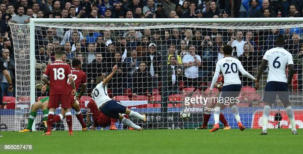 Harry Kane Scores the fourth for Tottenham during the Premier League match between Tottenham Hotspur and Liverpool at Wembley Stadium on October 22...