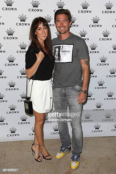Harry Kewell and his wife Sheree Murphy pose as they arrive at the IMG tennis players party at Crown Towers on January 12 2014 in Melbourne Australia