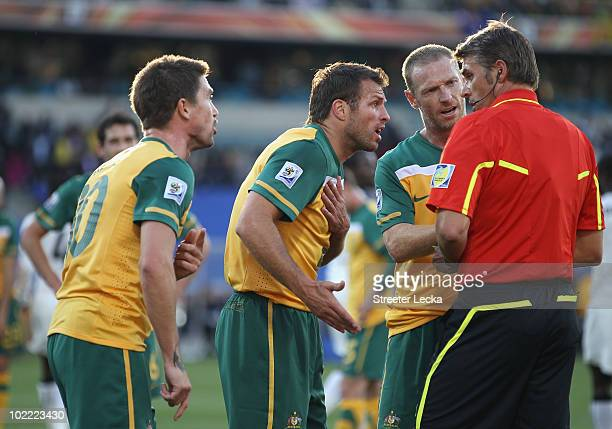 Harry Kewell Lucas Neill and Craig Moore of Australia argue with the referee Roberto Rosetti after he sends off Kewell for handball and awards Ghana...