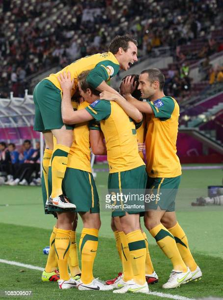 Harry Kewell of Australia celebrates his goal with teammates during the AFC Asian Cup Semi Final match between Uzbekistan and the Australian...