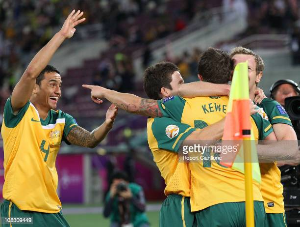 Harry Kewell of Australia celebrates his goal with Tim Cahill Matt McKay and David Carney during the AFC Asian Cup Semi Final match between...