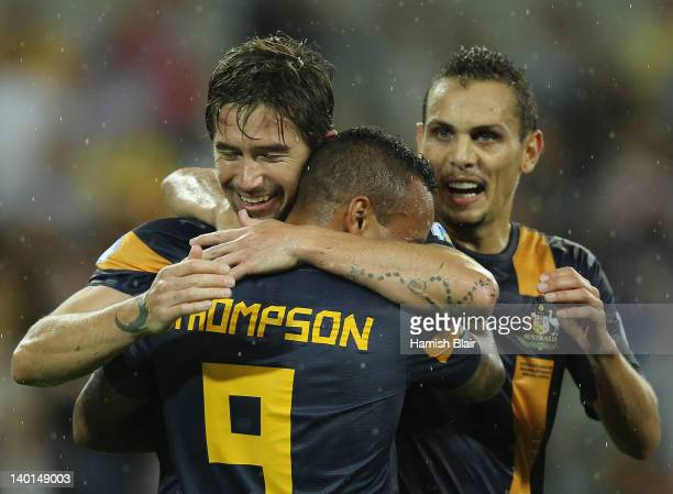 Harry Kewell of Australia celebrates their second goal with team mate Archie Thompson during the Group D 2014 FIFA World Cup Asian Qualifier match...