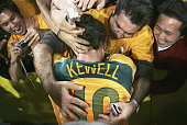 Harry Kewell of Australia celebrates victory after the second leg of the 2006 FIFA World Cup qualifying match between Australia and Uruguay at...
