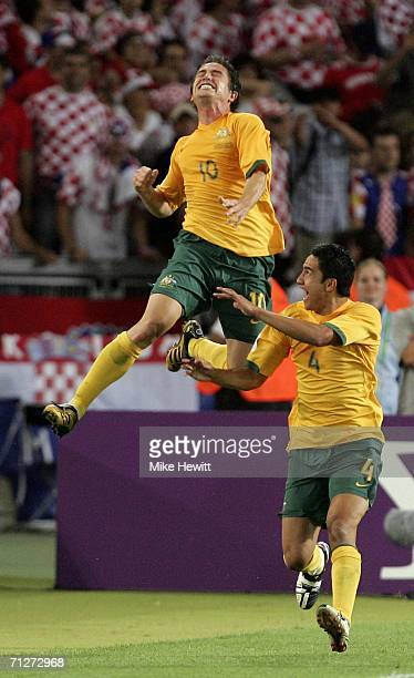 Harry Kewell of Australia celebrates with teammate Tim Cahill after scoring his team's second goal to level the scores at 22 during the FIFA World...