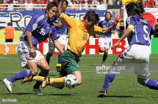 Harry Kewell of Australia competes for the ball with Takashi Fukunishi and Tsuneyasu Miyamoto of Japan during the FIFA World Cup Germany 2006 Group F...