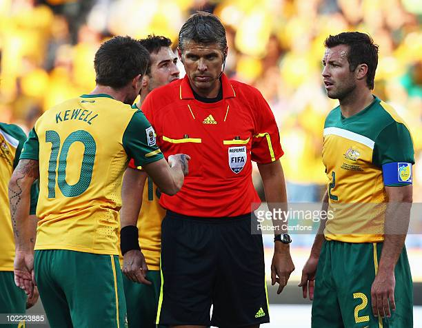 Harry Kewell of Australia explains the ball hit his chest and Lucas Neill pleads with the referee as Roberto Rosetti sends off Kewell for handball...