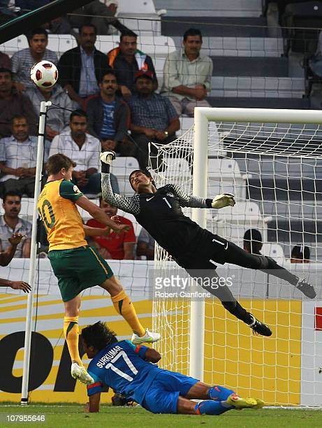 Harry Kewell of Australia has his shot on goal saved by Indian goalkeeper Subrata Paul during the AFC Asian Cup Group C match between India and...