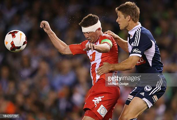 Harry Kewell of the Heart and Adrian Leijer of the Victory contest for the ball during the round one ALeague match between the Melbourne Victory and...
